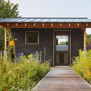 Idées déco pour un abri de jardin séparé scandinave.