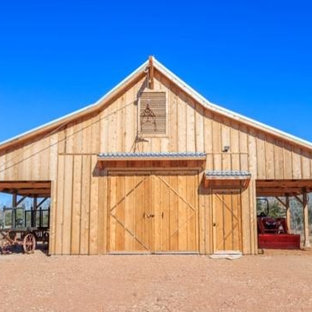Photo of an expansive farmhouse detached barn in Austin.