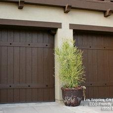 Mediterranean Garage And Shed by Dynamic Garage Door