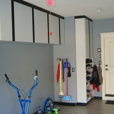 modern garage and shed by Kay Wade, Closet Factory