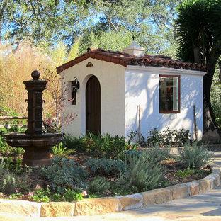 Small mediterranean detached garden shed in Santa Barbara.