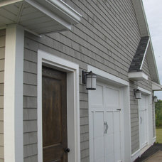 Traditional Garage And Shed by Acorn Construction