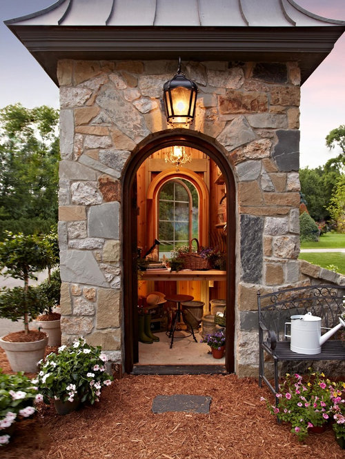 Stone lake house for Traditional garden buildings