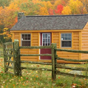 Summer Log Cabin Shed in Pasture