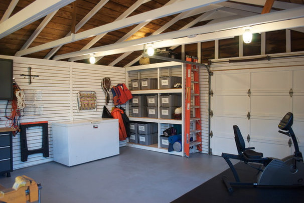 Eclectic Garage And Shed by The Design Den Homes Inc.