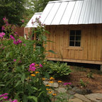 """Suzanne's Garden Shed - Suzanne had looked for a long time for storage for her garden tools. She called as soon as she saw our display. She says she just """"loves it""""."""