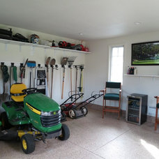 Traditional Garage And Shed by Archevie Design