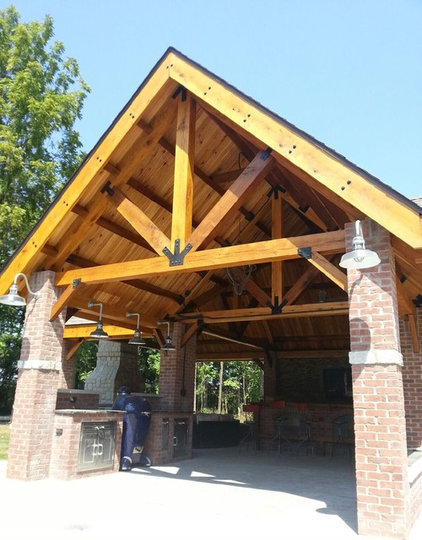 Rustic Garage And Shed by Above and Beyond Companies, Inc.