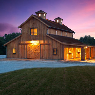 Example of a country detached barn design in Dallas