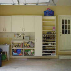 Traditional Garage And Shed by Artisan Custom Closets
