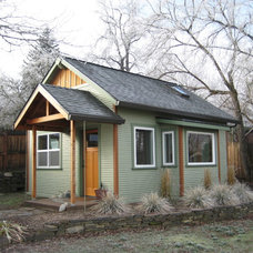 Traditional Garage And Shed by Conscious Construction Inc.