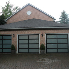 Traditional Garage And Shed by Garage Door Depot