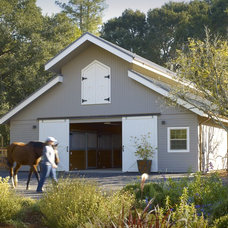 Rustic Garage And Shed by SDG Architecture, Inc.
