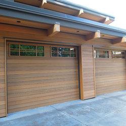 Wood flush garage door wood flush insulated with custom for Garage door wood overlay