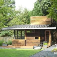 Rustic Garage And Shed by CORE Landscape Group