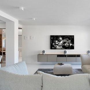 Idee per un ampio soggiorno contemporaneo aperto con sala formale, pareti bianche e TV a parete