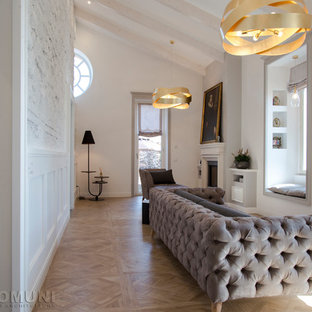 Example of a large cottage chic open concept porcelain floor and brown floor family room design in Rome with white walls, a standard fireplace, a stone fireplace and a wall-mounted tv