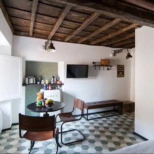 Imagen de salón con barra de bar abierto, industrial, pequeño, con paredes blancas, suelo de baldosas de porcelana, televisor colgado en la pared y suelo verde