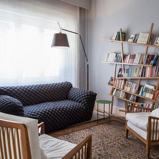 Ispirazione per un soggiorno design con pareti verdi e pavimento beige