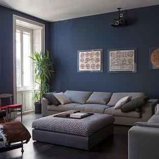 Esempio di un soggiorno minimal con pareti blu, pavimento in cemento e pavimento grigio