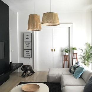 Immagine di un soggiorno contemporaneo di medie dimensioni con pareti bianche