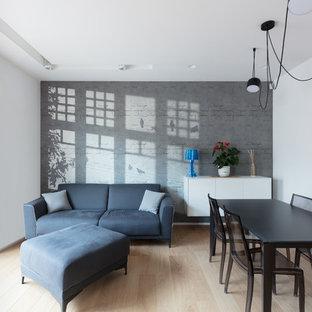Ispirazione per un soggiorno minimal con sala formale, pareti bianche, parquet chiaro e pavimento beige