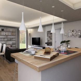 Exemple d'un grand salon tendance ouvert avec une salle de réception, un mur beige, un sol en bois clair, un téléviseur fixé au mur, un sol marron et un plafond décaissé.