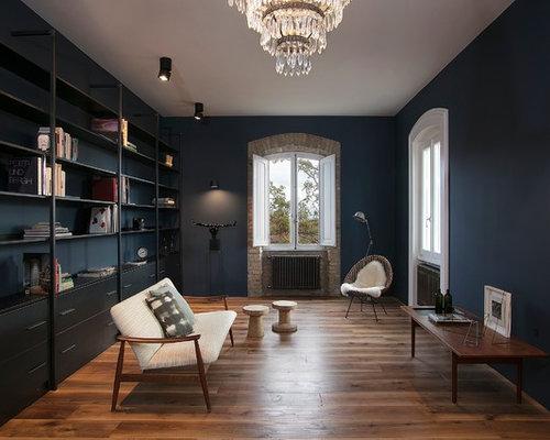 Soggiorno di medie dimensioni con pareti blu - Foto e Idee per ...