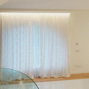 Family room - modern family room idea in Rome