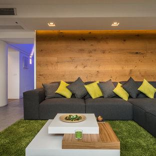 Ispirazione per un grande soggiorno design aperto con pareti bianche