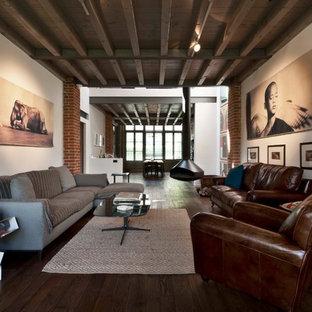 Ispirazione per un soggiorno design aperto con sala formale, pareti bianche, parquet scuro e camino sospeso
