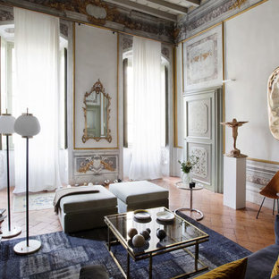 Photo of a large victorian formal enclosed living room in Milan with brick floors.