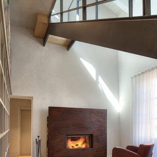Ispirazione per un grande soggiorno minimalista aperto con pareti bianche, parquet chiaro, camino lineare Ribbon e cornice del camino in metallo