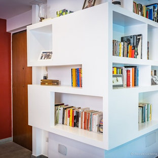 Minimalist open concept porcelain floor and gray floor living room library photo in Rome with red walls
