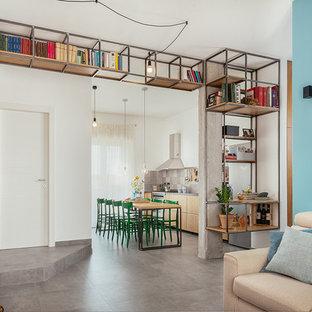 Esempio di un soggiorno industriale aperto con libreria, pareti blu, pavimento in gres porcellanato, pavimento grigio e nessun camino