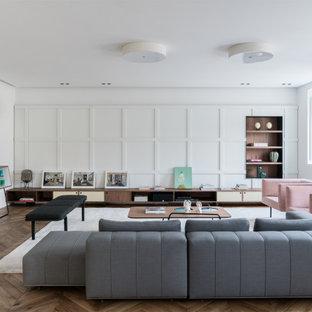 Foto di un ampio soggiorno contemporaneo aperto con pareti bianche, parquet chiaro e pavimento beige
