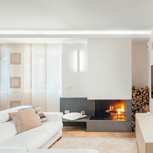 Example of a trendy open concept terra-cotta tile family room design in Naples with white walls, a concrete fireplace and a corner fireplace