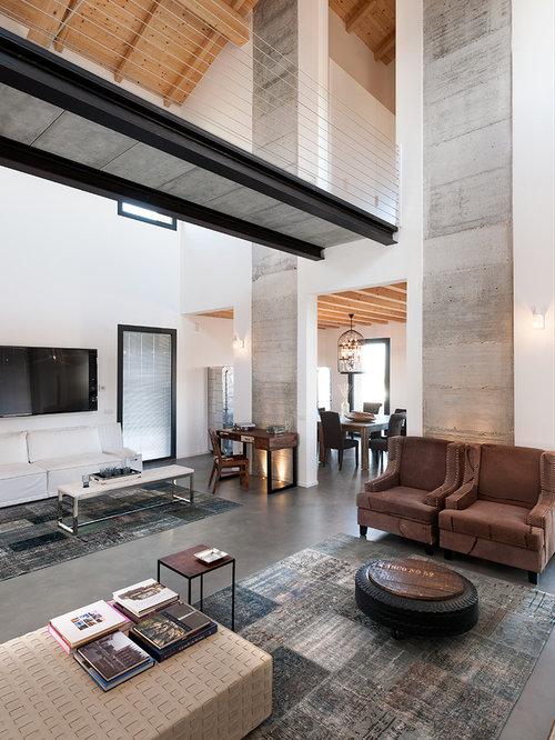 Foto e idee per soggiorni soggiorno industriale for Cemento industriale in casa