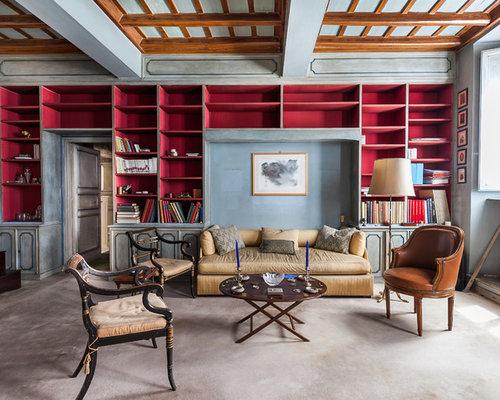 Salon avec une biblioth que ou un coin lecture avec un sol en moquette et un mur bleu photos Amenagement d un coin lecture cosy