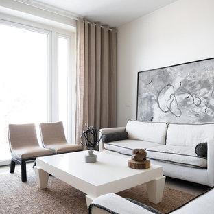 Foto di un soggiorno contemporaneo con pareti bianche e pavimento grigio