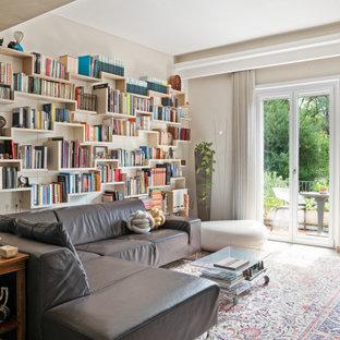 Foto di un soggiorno contemporaneo aperto con libreria e pareti beige