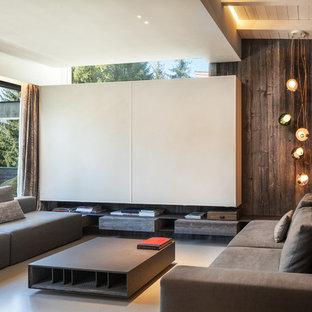 Esempio di un soggiorno minimal aperto con pareti multicolore, TV nascosta e pavimento grigio