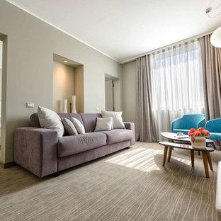Esempio di un soggiorno design di medie dimensioni e aperto con pareti grigie, moquette e pavimento grigio