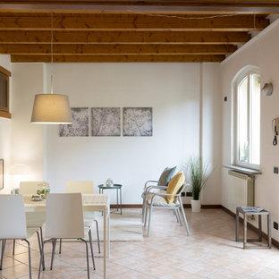 Idéer för att renovera ett mellanstort funkis allrum med öppen planlösning, med rosa golv