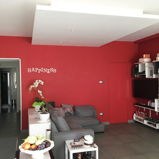 Mid-sized trendy open concept porcelain floor and gray floor living room library photo in Naples with red walls and a wall-mounted tv