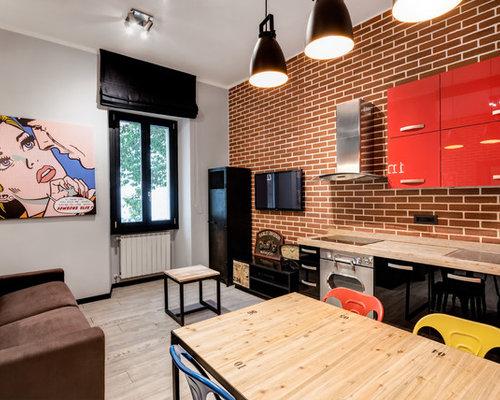 wohnzimmer im loft style mit porzellan bodenfliesen. Black Bedroom Furniture Sets. Home Design Ideas