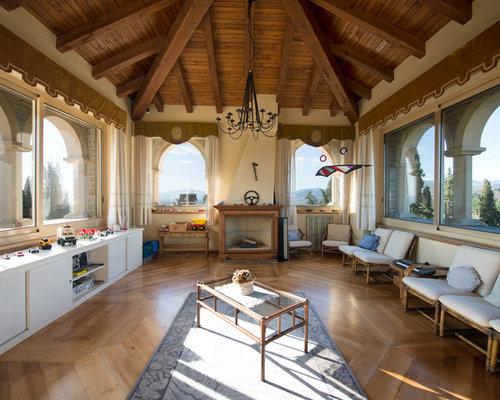 Foto e idee per soggiorni soggiorno con camino classico - Soggiorni con camino ...