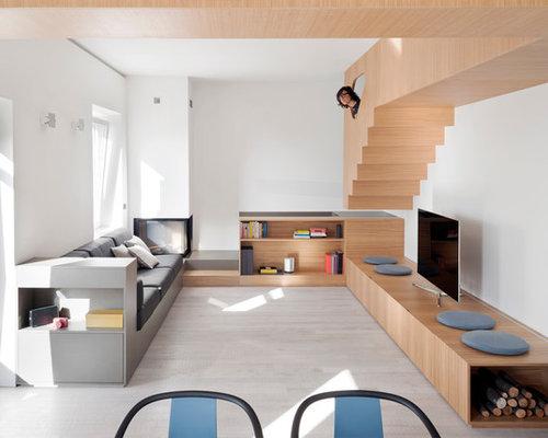 Foto e idee per living living moderno con camino ad angolo for Soggiorno moderno ad angolo