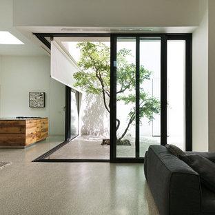 Ispirazione per un grande soggiorno moderno stile loft con pareti bianche, pavimento in cemento, camino lineare Ribbon e pavimento grigio
