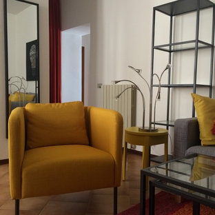 Family room - modern family room idea in Milan